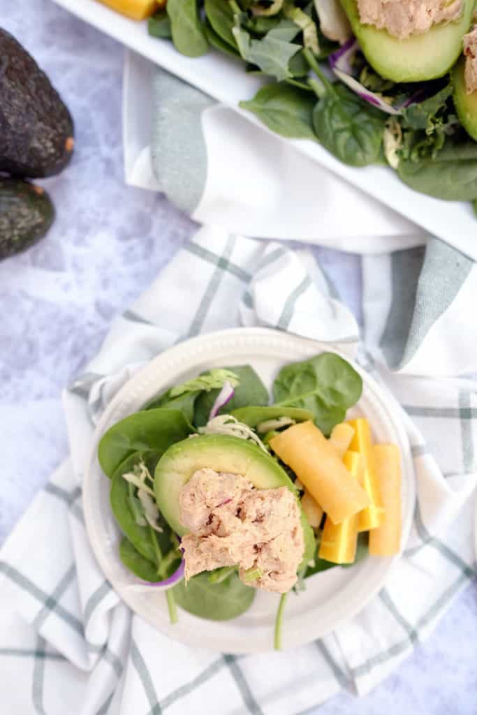Do you struggle with lunch ideas, or are you looking for ways to up your lunch game? Here's a fresh Paleo + Whole30 idea - chicken salad stuffed avocados. Paleo, Whlole30 + Dairy-Free. | realsimplegood.com