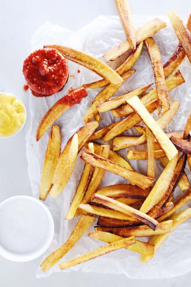 These paleo plantain fries are our cleaned-up version of the classic salty side of fries. Dunk them in ketchup and enjoy a burger and fries - Paleo style! Gluten-Free and Paleo. | realsimplegood.com