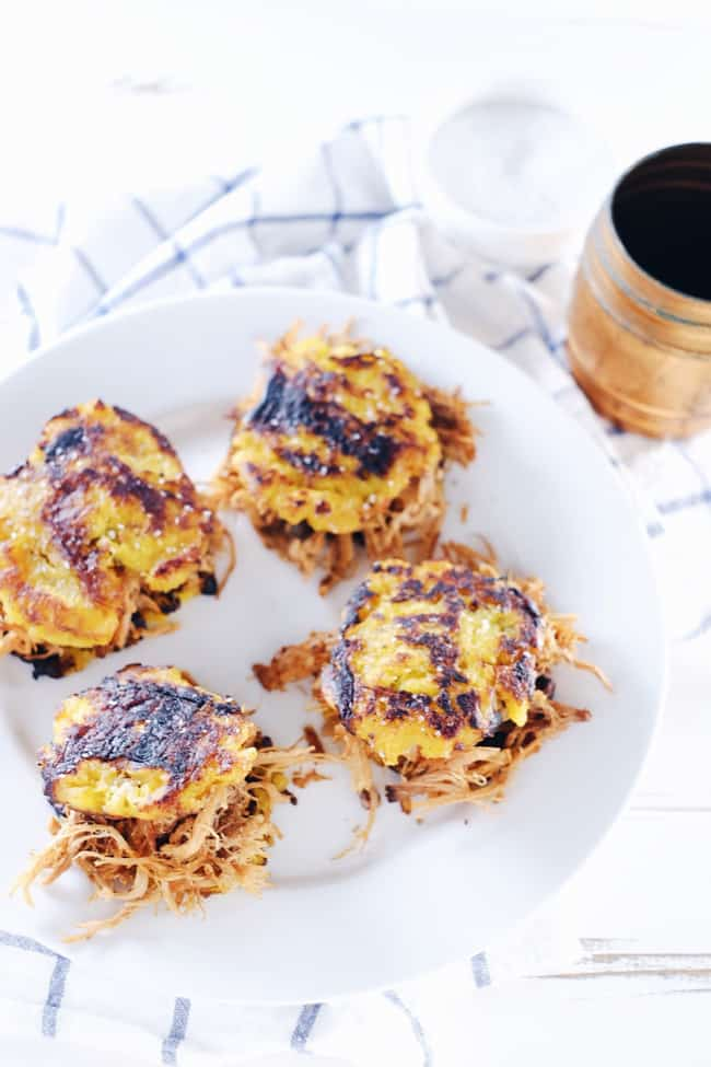 These plantain pulled pork sliders are so much fun! Pulled pork piled high on top of a fried plantain bun is a crispy treat that can't be beat. Paleo, Gluten-Free + Whole 30. | realsimplegood.com