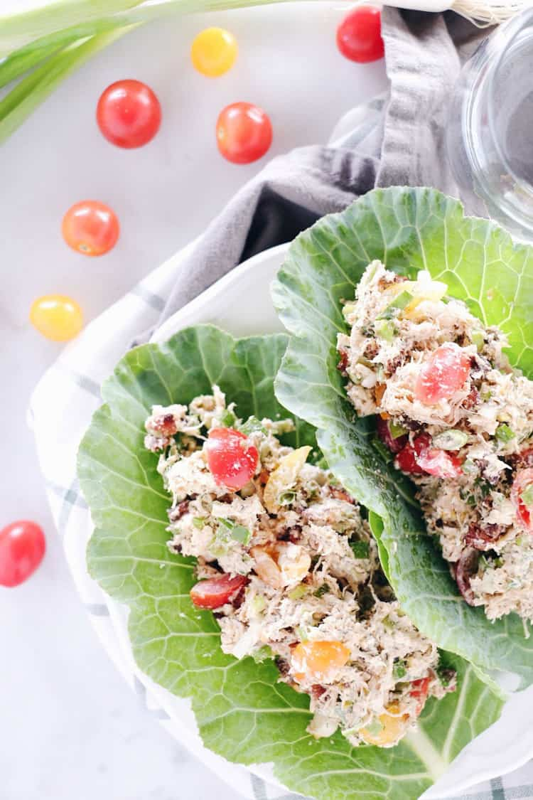 We've got all the flavors of a BLT wrapped up in this Paleo + Whole30 BLT chicken salad! We love to eat it in lettuce shells or as an easy snack + dip. Paleo, Whole30, Gluten-Free + Dairy-Free. | realsimplegood.com