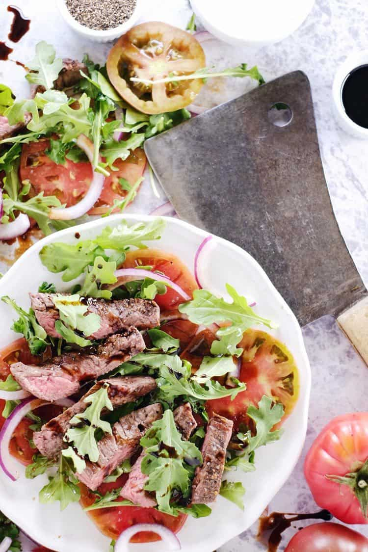 We love this simple steak salad because there are just a handful of ingredients, nothing flashy or obscure. It is a simple, nourishing and delicious dish! Paleo, Gluten-Free, + Dairy-Free. | realsimplegood.com