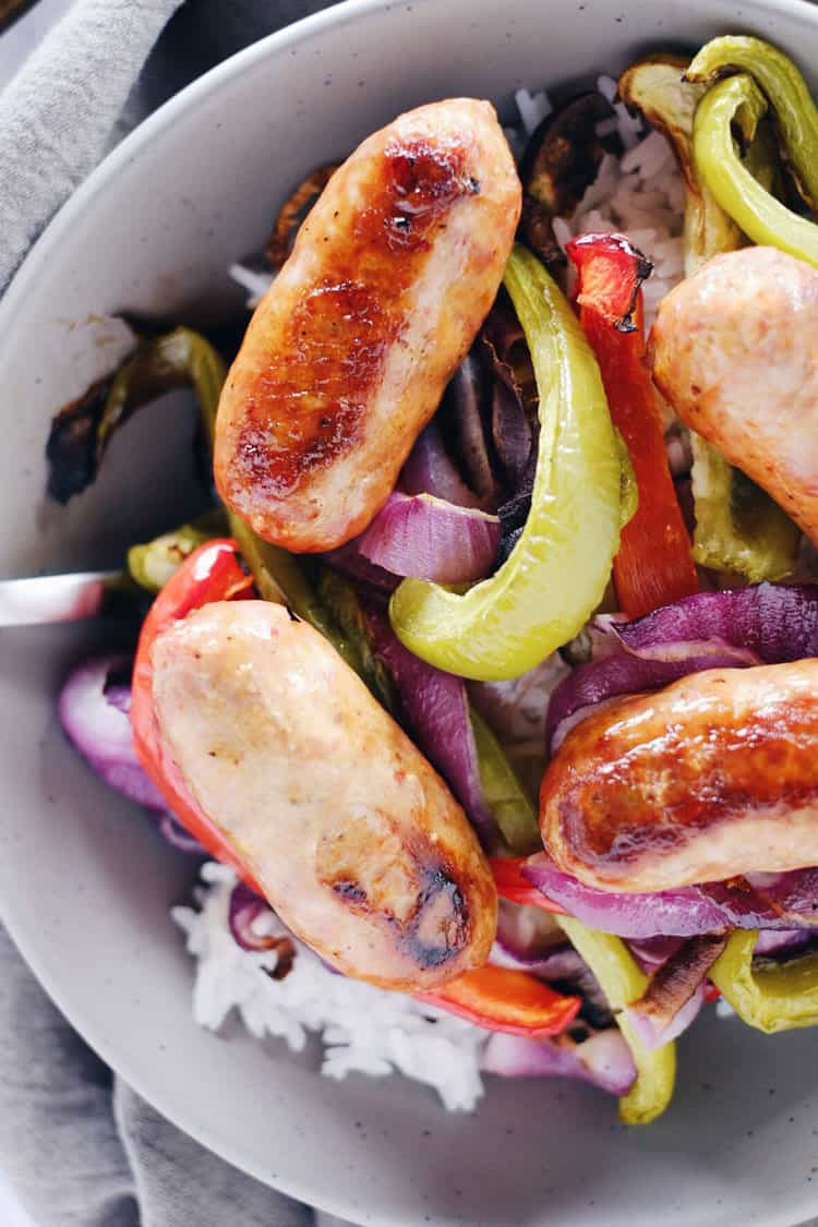 Are you looking for a super simple, easy weeknight meal? We've got you covered with this one pan Italian sausage with onions and peppers. Paleo + Gluten-Free. | realsimplegood.com