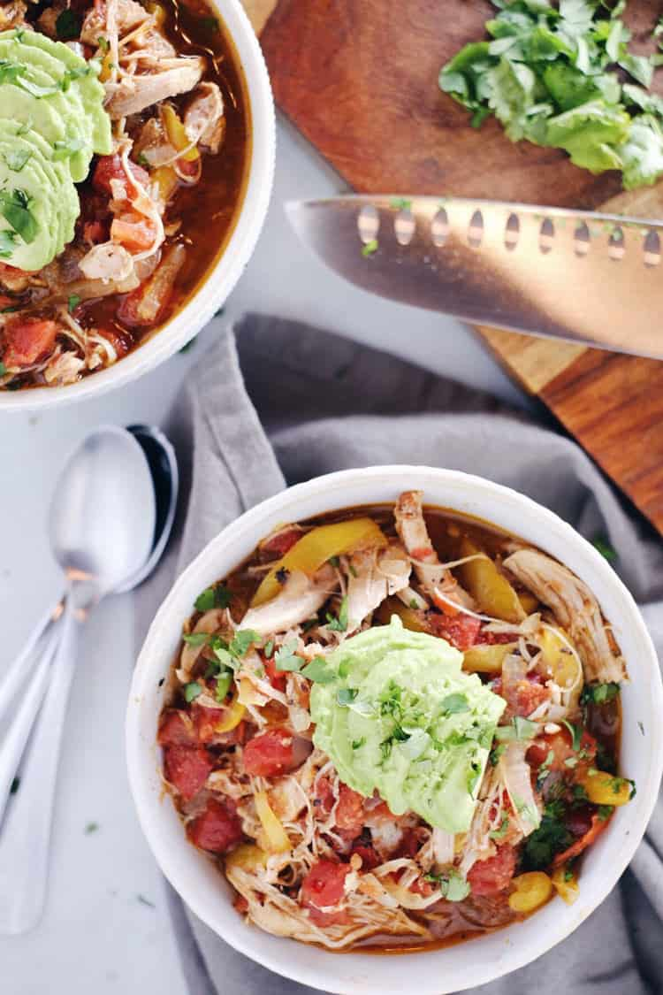Since the weather turned chilly, this crockpot chicken enchilada soup is one that we've had on repeat! It's so tasty and warming. Paleo, Whole30, Gluten-Free + Dairy-Free. | realsimplegood.com