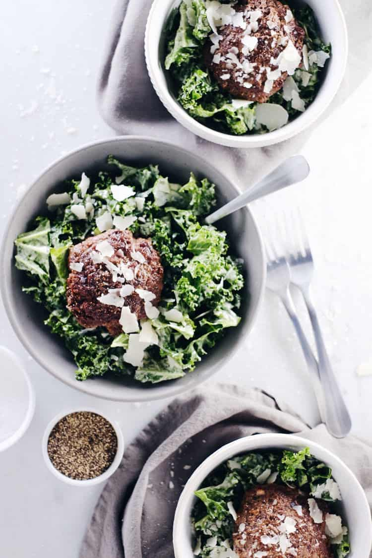 This kale caesar burger bowl is simple and satisfying with a Paleo caesar dressing and optional cheese topping. Quick, easy and great any meal of the day. Paleo, Gluten-Free + Dairy-Optional. | realsimplegood.com