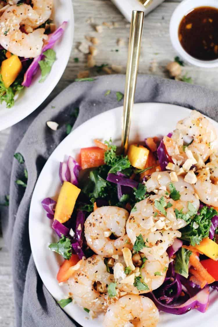 This chopped Thai shrimp salad is like eating the rainbow! It's packed with fruit, veggies and fresh herbs! Make this nutritious salad filled with kale, cabbage, bell pepper, carrots, mango and cilantro. It's super easy and quick to make! Paleo, Gluten-Free, Dairy-Free + Refined Sugar-Free. | realsimplegood.com