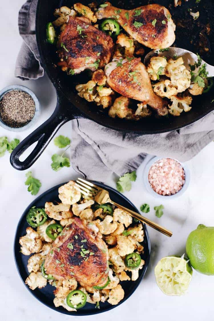 Crispy chicken thighs with zesty cauliflower are the perfect Paleo + Whole30 spicy meal. Packed with flavor, including citrus, cilantro and jalapeño! Paleo + Whole30. | realsimplegood.com