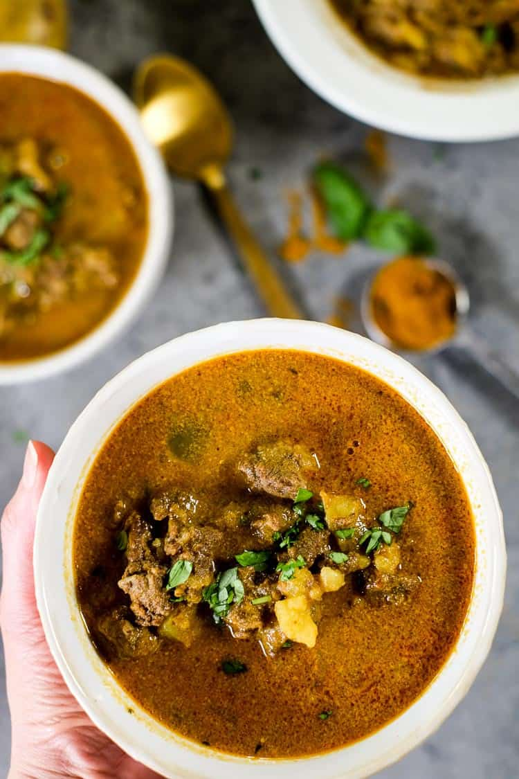 This Paleo and Whole30 curry beef stew is real good, and we've provided you instructions to make it in either the Instant Pot or slow cooker! It's packed with comfort foods like potatoes, savory curry flavors, gut healing bone broth and creamy coconut milk.   realsimplegood.com #paleo #whole30 #instantpot #slowcooker