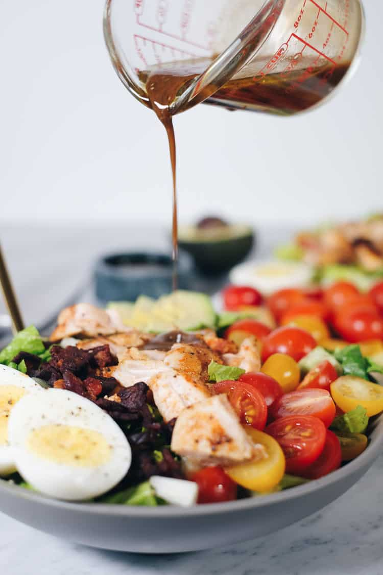 This easy Paleo cobb salad is packed with all the flavors, like smoky bacon, creamy avocado, fresh tomatoes and a tangy balsamic dressing!It's Whole30 too! | realsimplegood.com