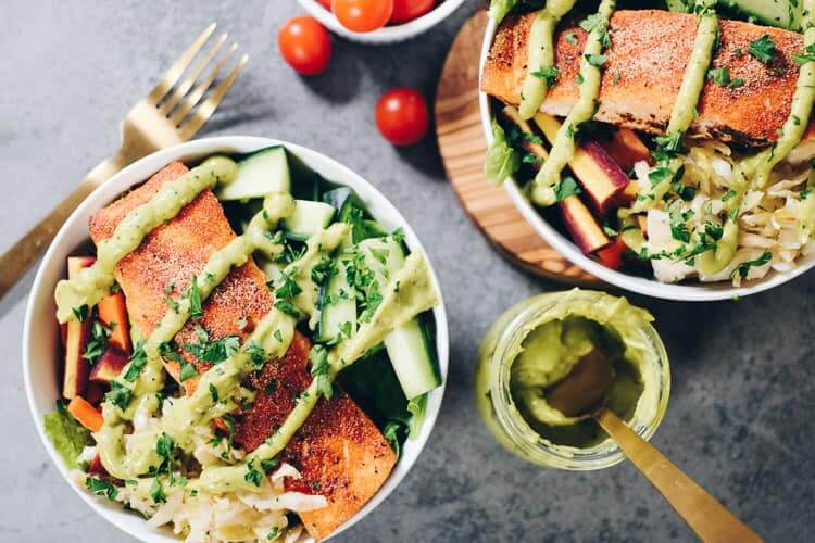 These easy Whole30 and Paleo Salmon Salad Bowls are the perfect way to sneak more salmon in and make a meal that you will absolutely look forward to making again! It's packed with healthy fats and colorful veggies your body will love! #paleolife #whole30meals #whole30 #healthyfats | realsimplegood.com