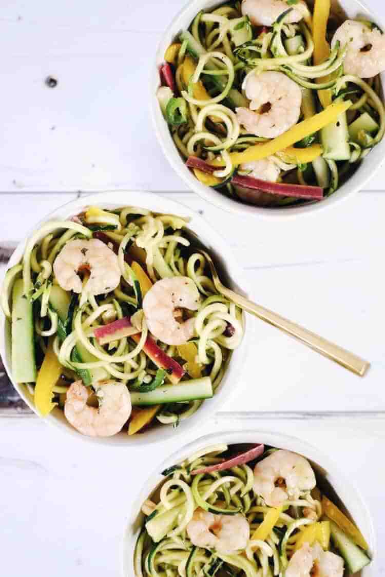 This shrimp zoodle spring roll bowl is packed with fresh and vibrant flavors and colors! It's light and refreshing, yet satisfying at the same time! Paleo, Whole30, Gluten-Free, Soy-Free + Dairy-Free.   realsimplegood.com