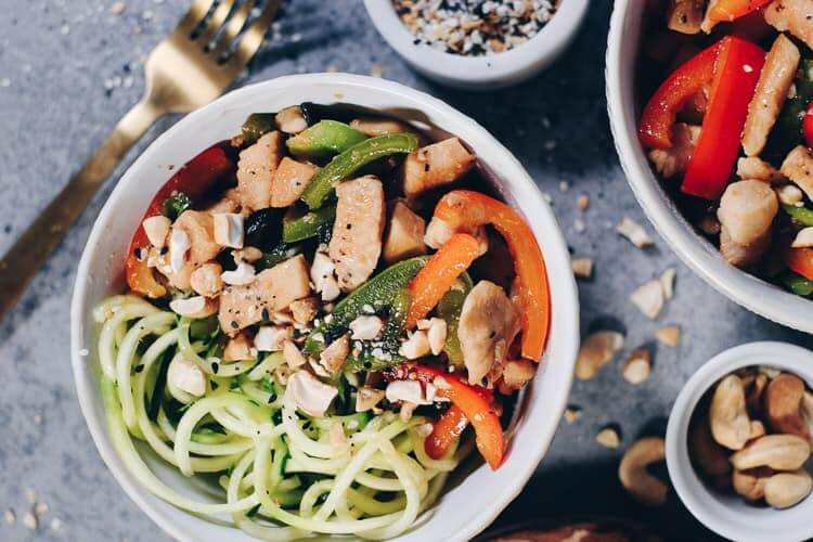 Here is a healthier teriyaki recipe, sweetened with maple syrup and paired with zoodles. Enjoy this Paleo and Whole30 Teriyaki Chicken Zoodles Bowl! You'll enjoy the colors and flavors! #paleo #glutenfree #soyfree #refinedsugarfree #whole30 | realsimplegood.com