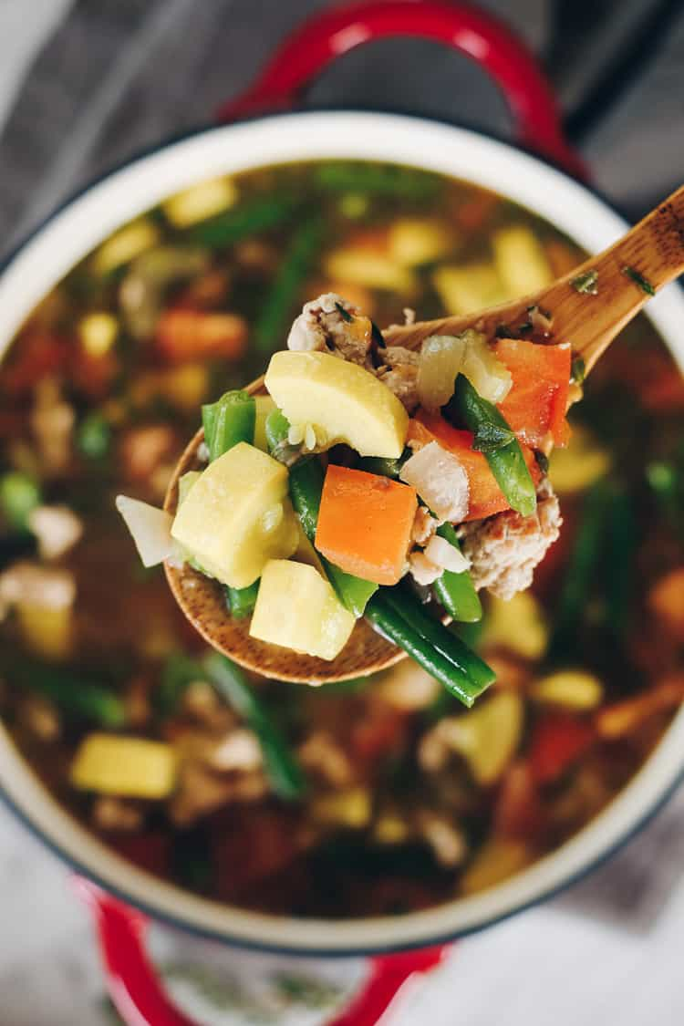 The abundance of summer produce inspired this Paleo and Whole30 turkey and summer vegetable soup. It's the perfect way to use up your garden fresh veggies! Filled with onion, celery, garlic, herbs, tomatoes and summer squash. Paleo + Whole30 | realsimplegood.com