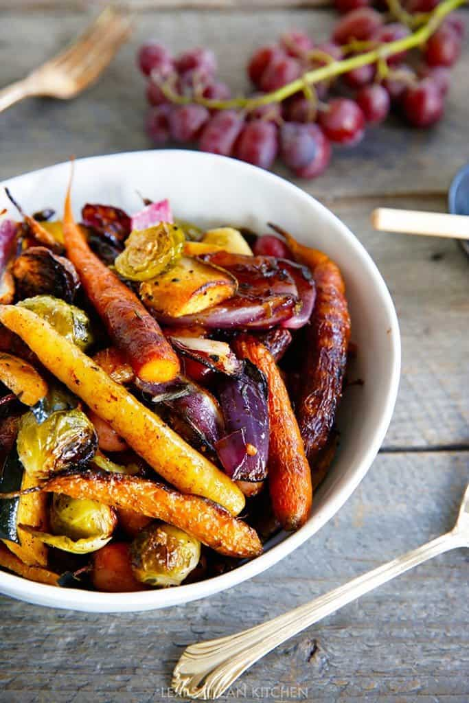 Roasted carrots, onion and brussels in a bowl