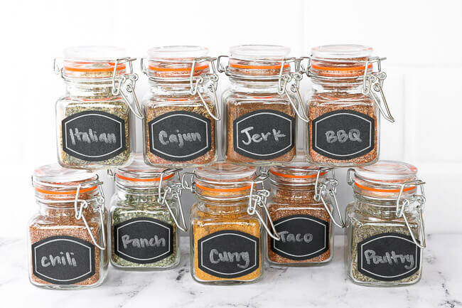 10 homemade spice blends in a jar with labels straight on photo