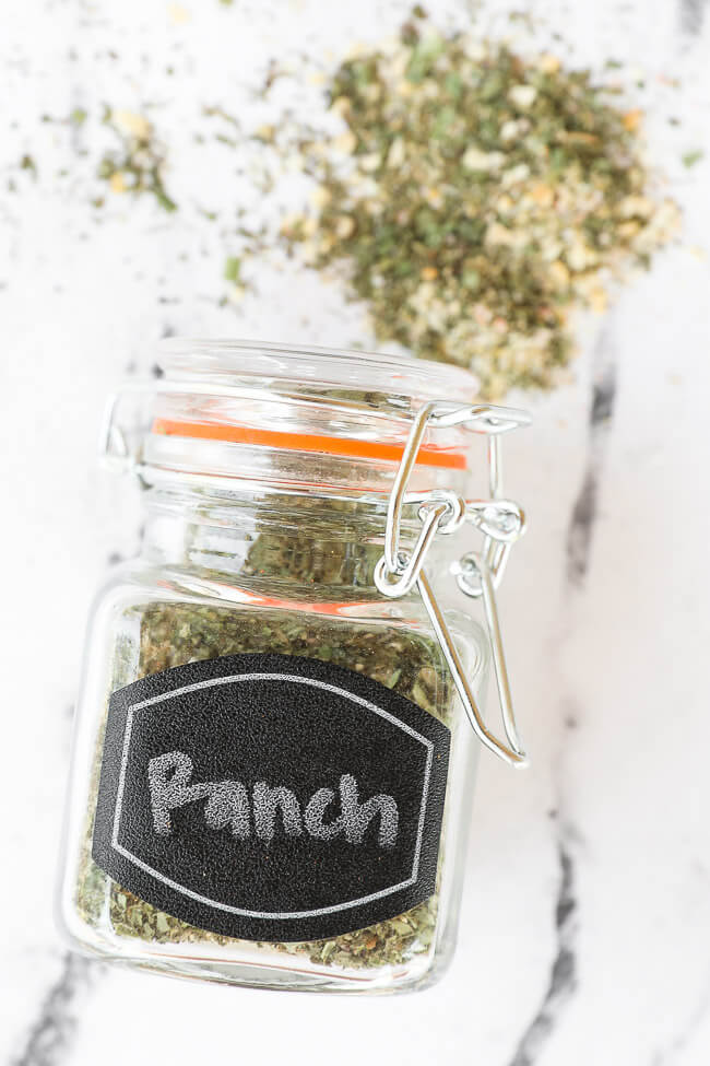 Ranch seasoning in a jar with label laying down on countertop