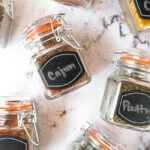 Homemade spice blends in jars laying on a countertop