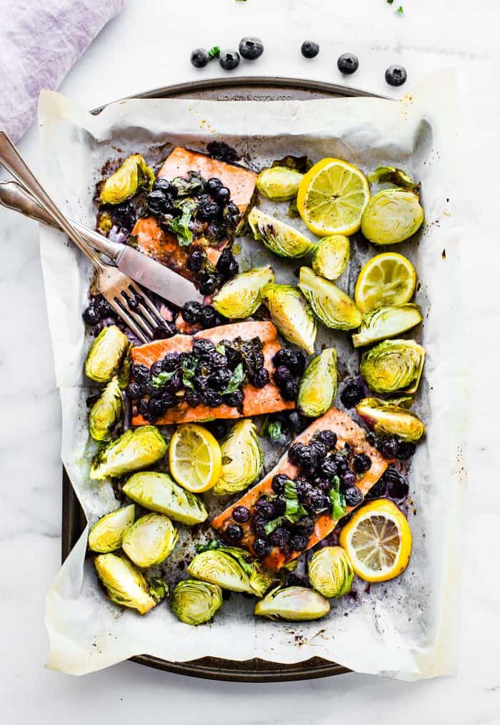 Brussels and salmon on sheet pan with blueberry topping