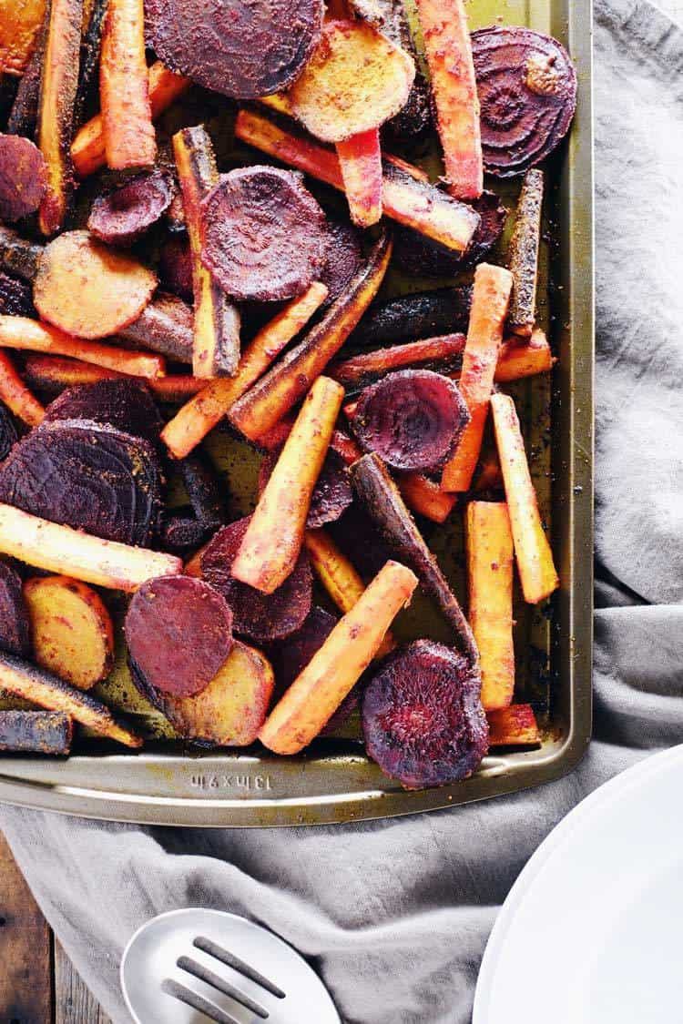 Roasted beets and carrots on a sheet pan