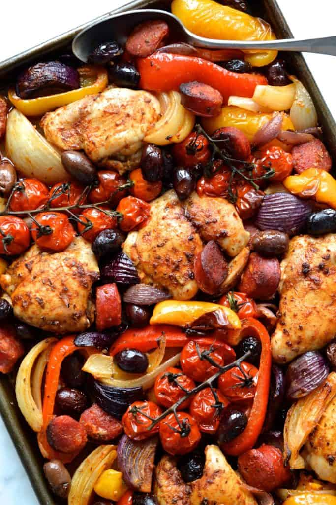 Sheet pan with chicken, peppers, onions and tomatoes