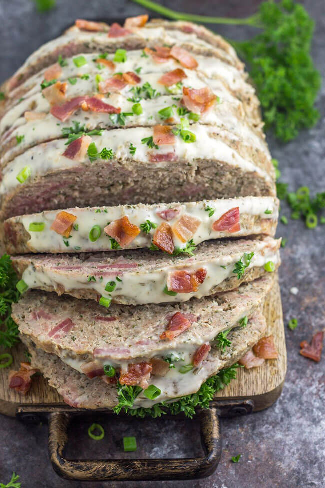 Sliced turkey bacon ranch meatloaf on a board angle shot