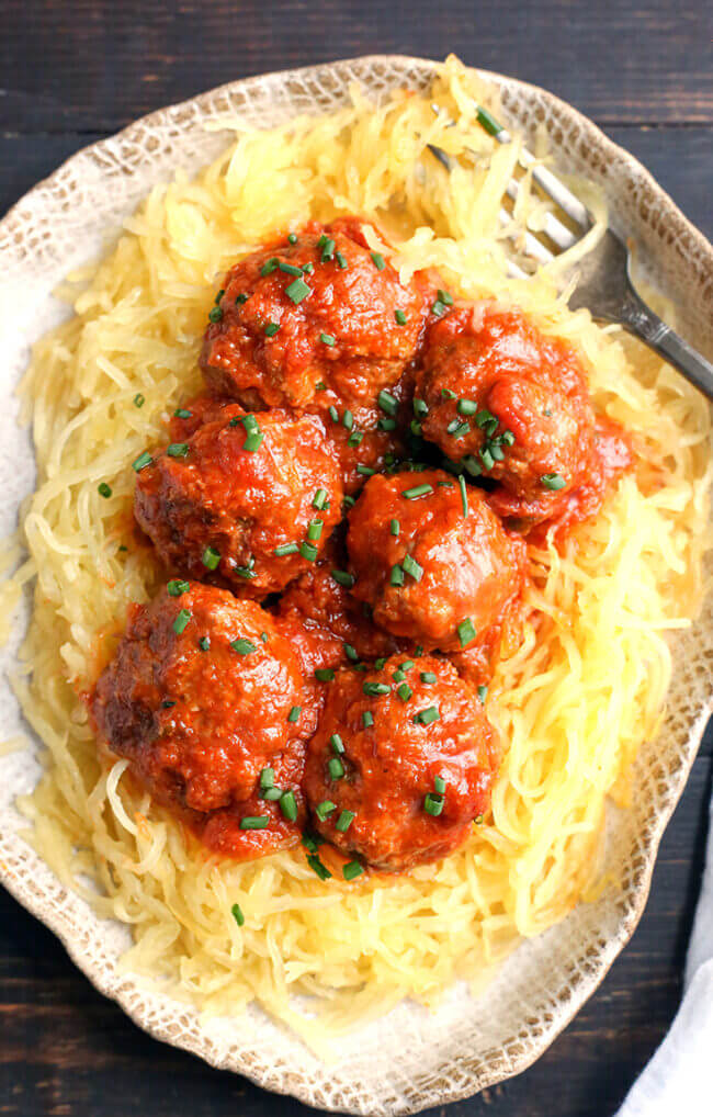 Plate of meatballs and red sauce over spaghetti squash