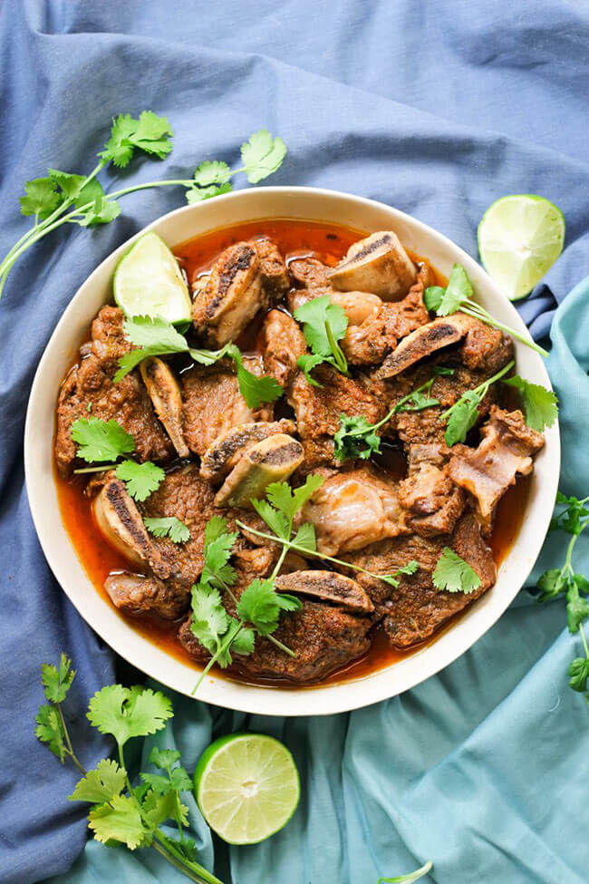 Chili lime instant pot short ribs in a bowl with cilantro topping overhead shot