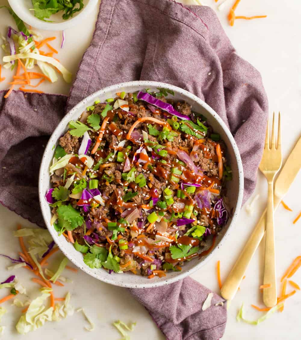 Egg roll in a bowl with ground beef, cabbage, cilantro and onion
