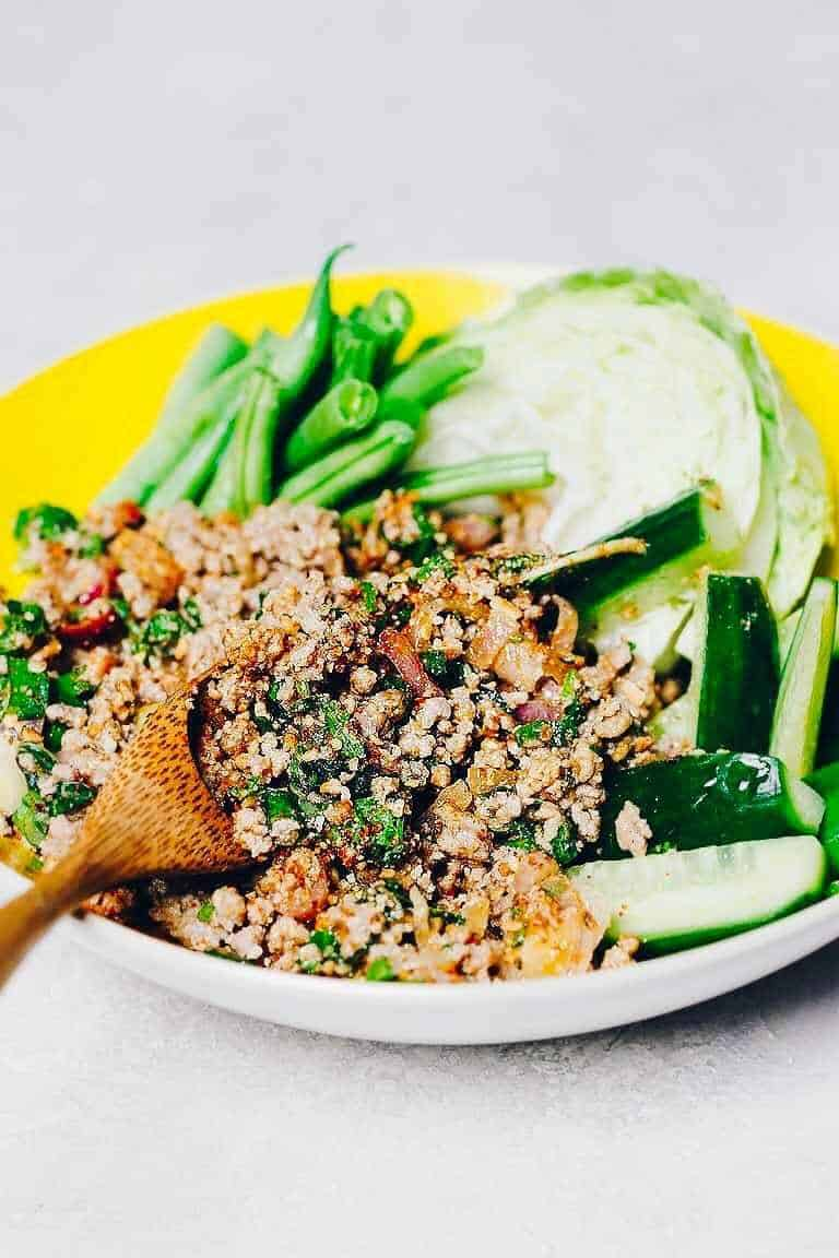Bowl with larb, green beans, cucumber and cabbage
