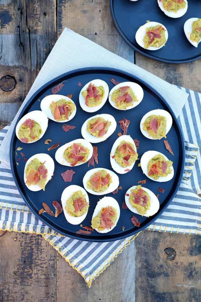 These mayo free deviled eggs have amix of creamy avocado combined with crispy and salty prosciutto. Easy to make and the perfect Paleo appetizer! Paleo and Gluten-Free.   realsimplegood.com