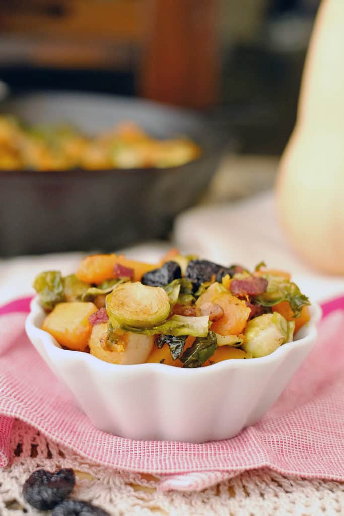 This Paleo + Whole30 roasted brussels squash side dish is a simple and flavorful dish to accompany any meal. Healthy and delicious all in one pan. Paleo + Whole30. | realsimplegood.com