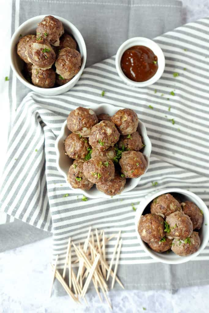 These elk meatballs are simple yet delicious and paired with the perfect sweet and spicy sauce for dipping. An easy and healthy appetizer! Paleo, Gluten-Free, Refined Sugar-Free. | realsimplegood.com