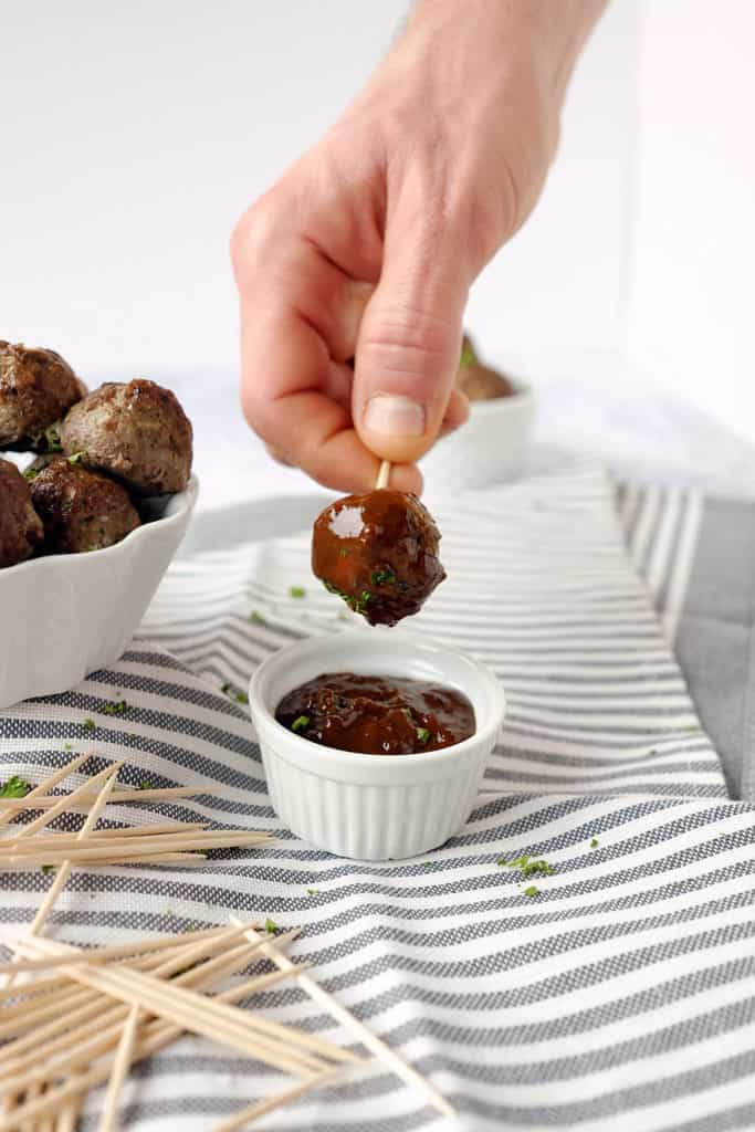 These elk meatballs are simple yet delicious and paired with the perfect sweet and spicy sauce for dipping. An easy and healthy appetizer! Paleo, Gluten-Free, Refined Sugar-Free. | realsimplegood.comThese elk meatballs are simple yet delicious and paired with the perfect sweet and spicy sauce for dipping. An easy and healthy appetizer! Paleo, Gluten-Free, Refined Sugar-Free. | realsimplegood.com