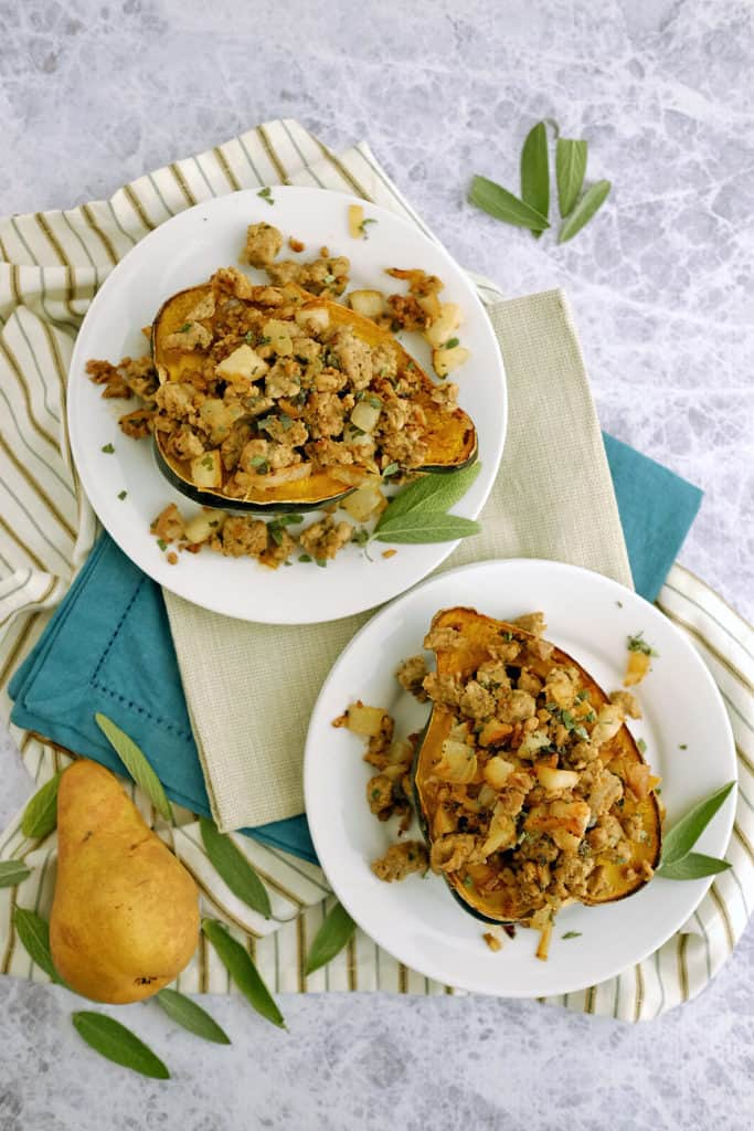 This Paleo + Whole30 pork and pear stuffed acorn squash has apples and squash paired with sausage, sage and onion for an easy, healthy meal. Paleo + Whole30. | realsimplegood.com