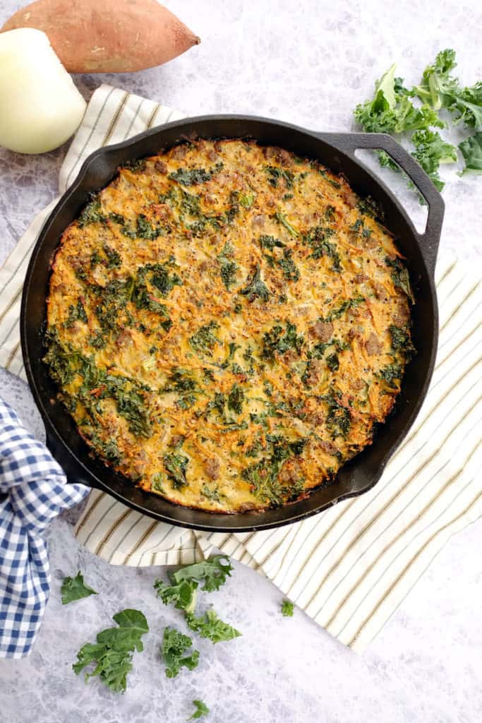 This Paleo + Whole30 sweet potato quiche has only six main ingredients is EASY to make. The eggs, sausage, kale, and sweet potaotes combine to make the perfect quiche. Paleo, Whole30, Dairy-Free, and Gluten-Free. | realsimplegood.com