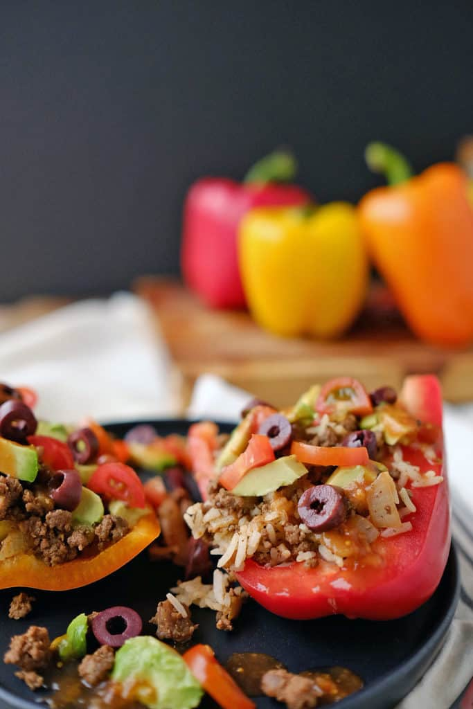 This is such an easy meal with so much flavor, it's kind of absurd. These Paleo + Whole30 taco stuffed bell peppers look so amazing and taste even better! Paleo + Whole30. | realsimplegood.com