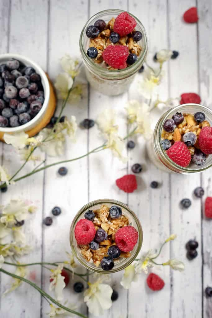 These berry granola parfaits are light and fluffy with a no-bake paleo granola and fresh berries. An easy snack to enjoy! Paleo, Gluten-Free, Dairy-Free and Refined Sugar-Free. | realsimplegood.com