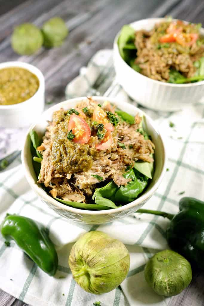 Tomatillos and chilies, garlic and cilantro blend to make the perfect sauce for tender pork in this easy Paleo + Whole30 crockpot pork chile verde recipe. Paleo + Whole30 | realsimplegood.com