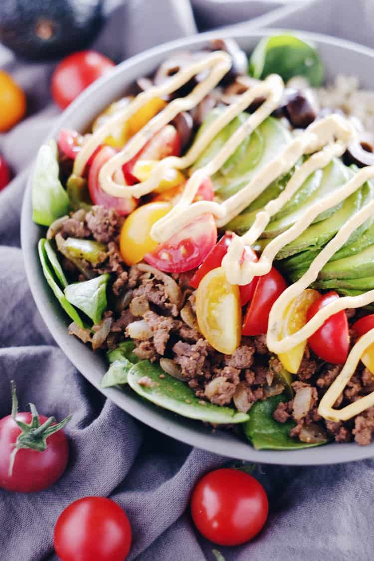 Paleo + Whole30 quick and easy ground beef taco bowls are healthy and loaded with flavor. Filled with ground beef, cauliflower rice, spinach and your favorite toppings. Paleo, Gluten-Free, Dairy-Free + Whole 30. | realsimplegood.com