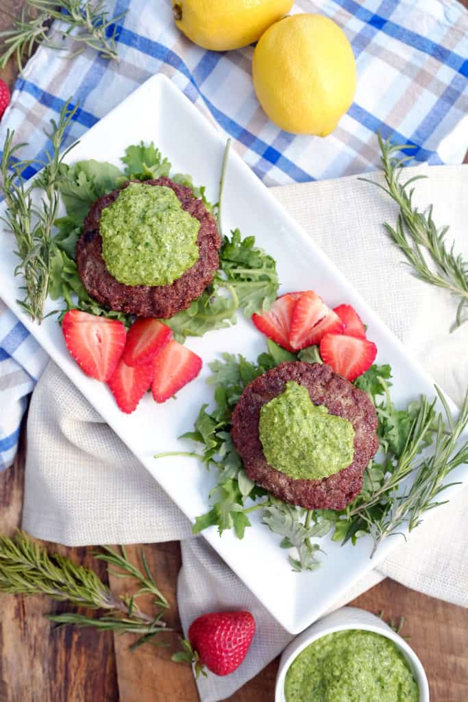Rich and flavorful, these lamb burgers with rosemary pesto sauce are a gourmet meal that can be on your plate in under 20 minutes. Paleo + Whole30 friendly. Paleo, Whole30, Gluten-Free and Dairy-Free. | realsimplegood.com