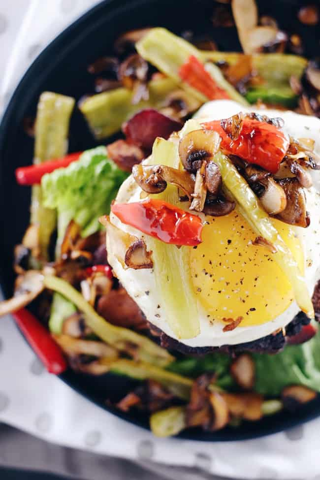 These chipotle bison burgers are an easy Paleo + Whole30 alternative to regular hamburgers. Topped with bacon, egg, peppers and mushrooms for amazing flavor! Paleo, Whole30, Gluten-Free + Dairy-Free | realsimplegood.com