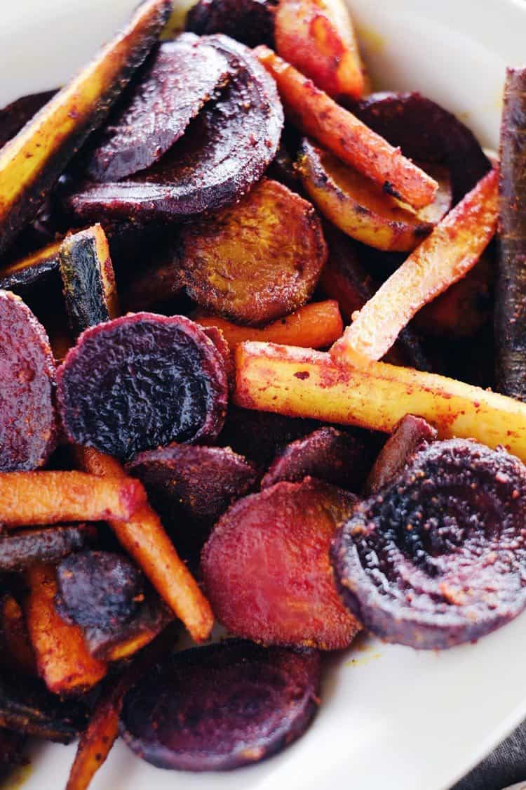 These turmeric maple roasted beets and carrots are an easy and delicious way to incorporate this powerful spice into your diet. Paleo + Gluten-Free | realsimplegood.com