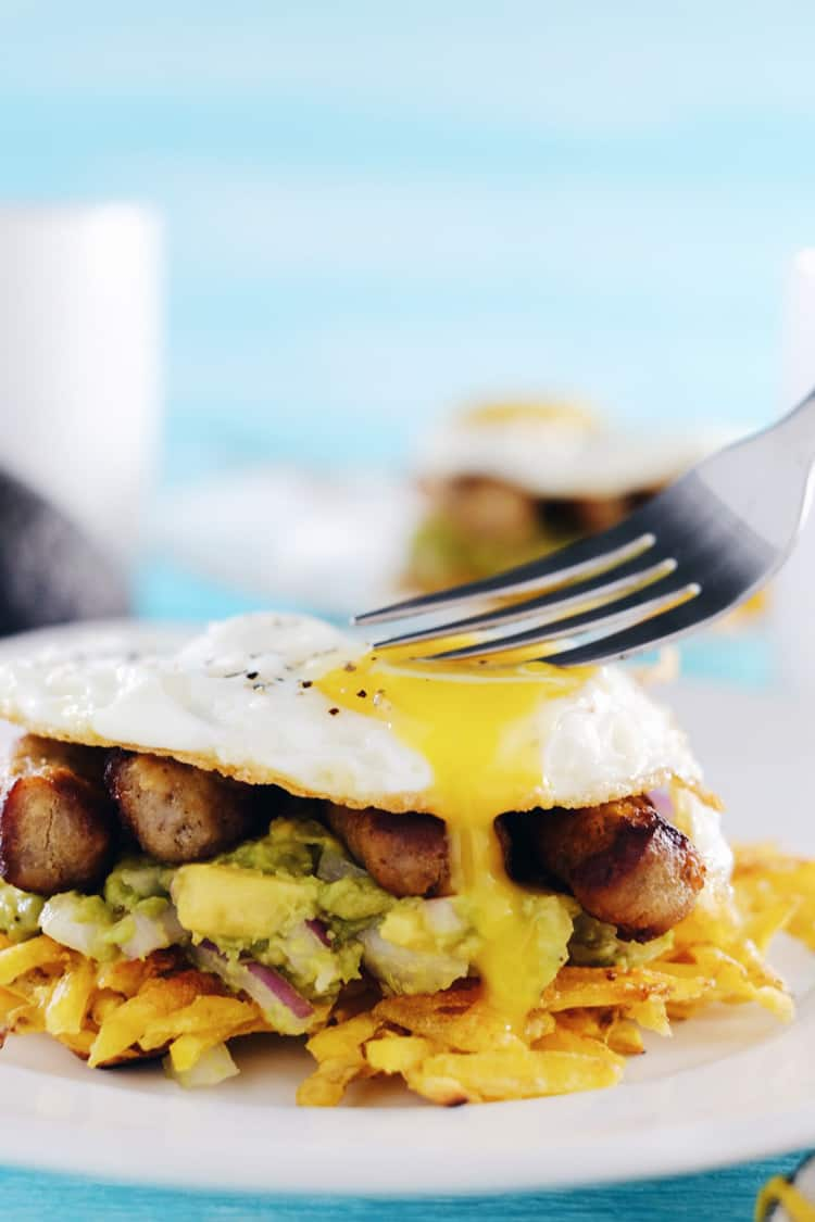These paleo breakfast stacks are an easy to make favorite. A Whole30 breakfast with plantain hash browns, simple guacamole, sausage and eggs! Paleo, Whole30, Gluten-Free + Dairy-Free. | realsimplegood.com