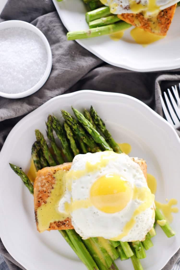 We love salmon, and we usually try to have it about once a week. This roasted salmon and asparagus with hollandaise sauce is our latest craze! Paleo + Gluten-Free. | realsimplegood.com