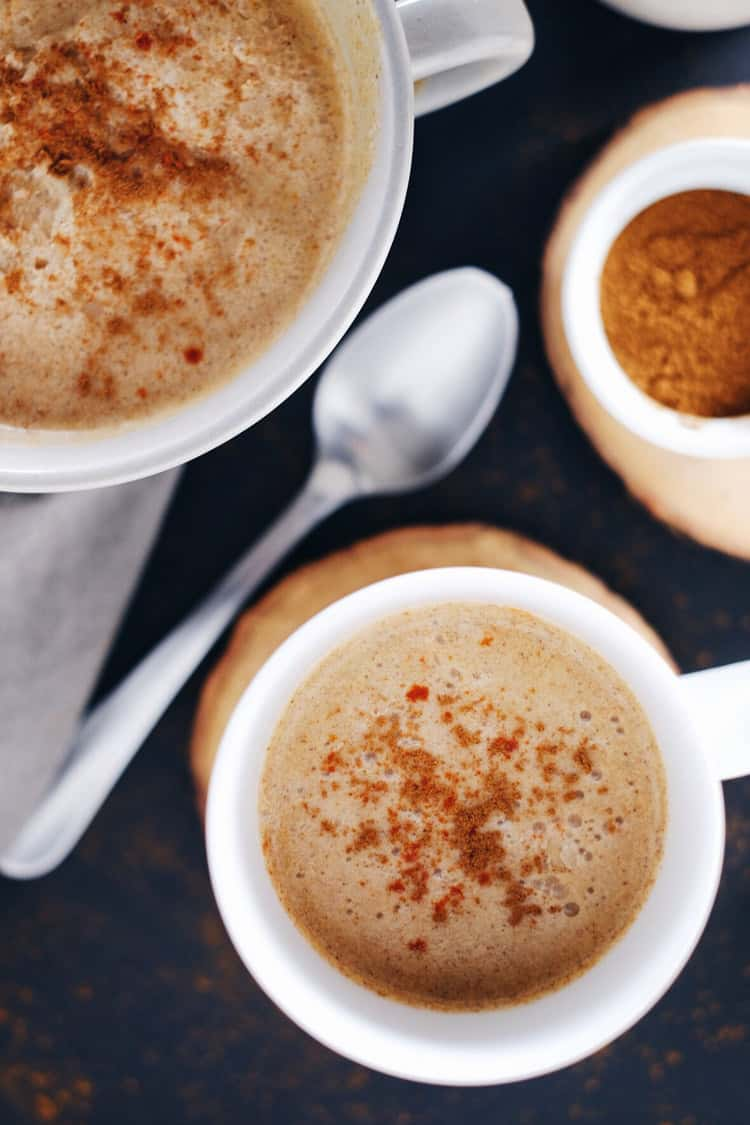 This spiced pumpkin coconut cider made with fresh pressed cider, coconut milk, cayenne, cinnamon and a couple other spices will keep you warm and cozy! Paleo, Gluten-Free, Dairy-Free + Refined Sugar-Free. | realsimplegood.com