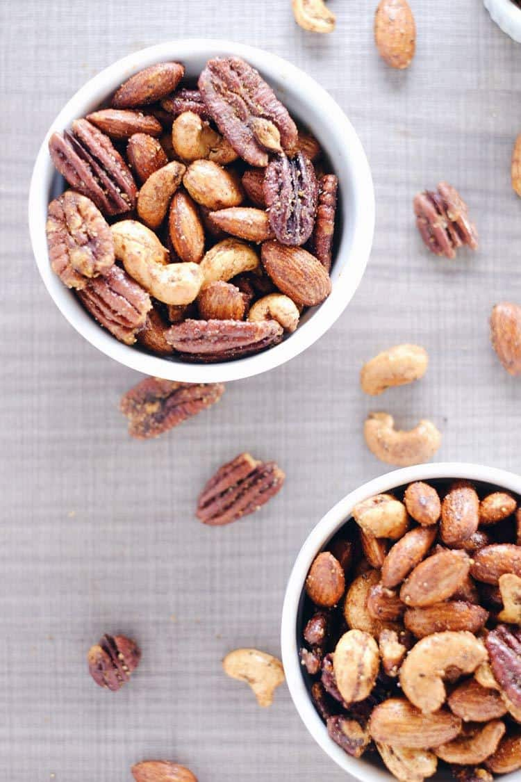These spicy nuts are a Paleo + Whole30 friendly way to enjoy mixed nuts for a snack. They are roasted with a simple blend of spices and seasonings. Paleo, Whole30, Gluten-Free + Sugar-Free. | realsimplegood.com