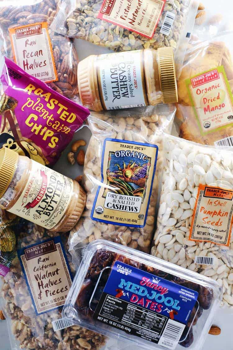 Here is a go-to list of Paleo Trader Joe's must haves! These are all clean Paleo products that you can find at your local TJ's. We've got organic veggies, clean meats (sausage, chicken, ground beef), frozen foods, oils, vinegars, pantry staples, snacks and baking items. It's all Paleo and Gluten-Free! | realsimplegood.com