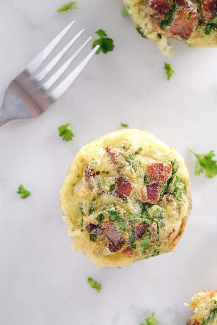 Don't slave in the morning to make a Paleo + Whole30 breakfast. Make these mushroom, spinach and bacon egg muffins ahead of time for easy weekday mornings! Paleo, Whole30, Gluten-Free + Dairy-Free. | realsimplegood.com