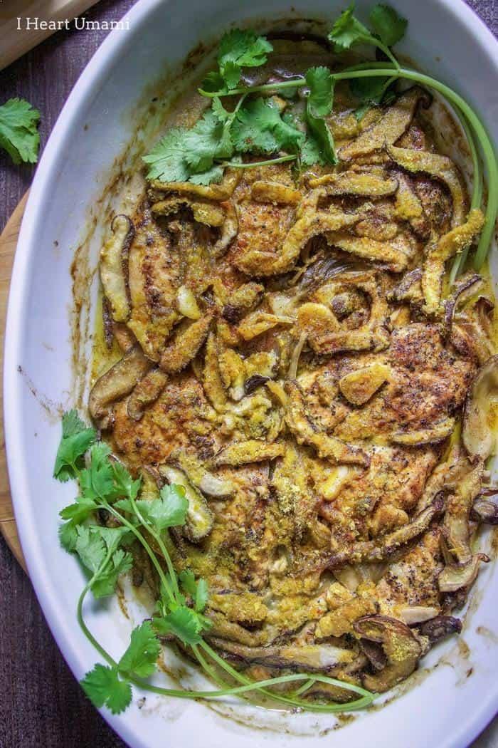 Creamy chicken mushroom casserole in gray dish with herbs - healthy casseroles