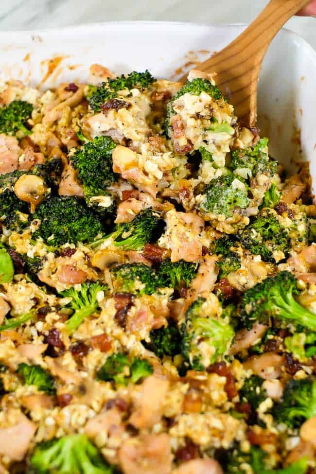 Healthy chicken and broccoli casserole close up angle shot with spoon in dish - healthy casseroles
