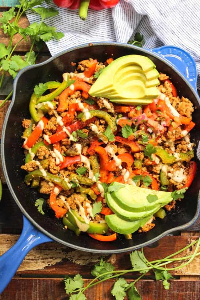 Chipotle chicken skillet with sauce and avocado topping
